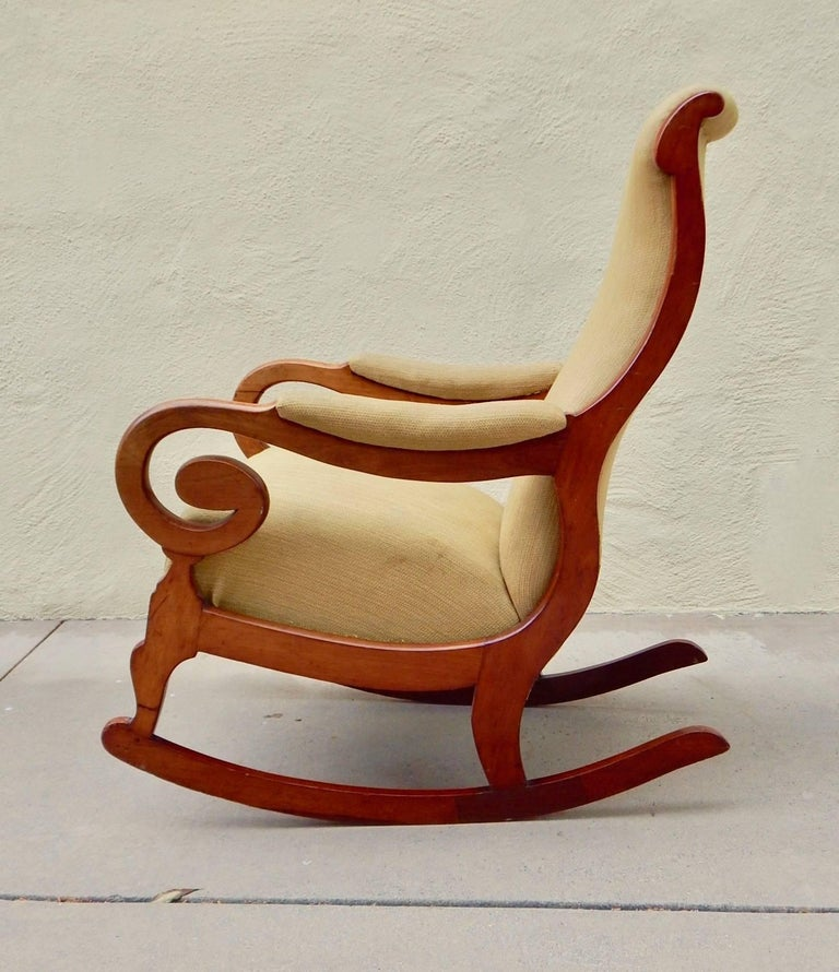 Swedish period Biedermeier rocking chair rendered in birch wood. In original fabric. In excellent structural condition. Wood has had some repairs, Sweden, circa 1850.