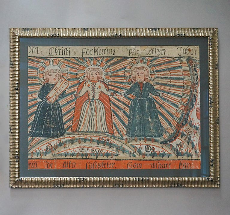 Fragment of larger Swedish bonad dated 1818 and illustrating the transfiguration of Jesus with Moses and Elijah on either side. We see the three men on a mountain top with the light of glory emanating from the central figure. Tempera on homespun