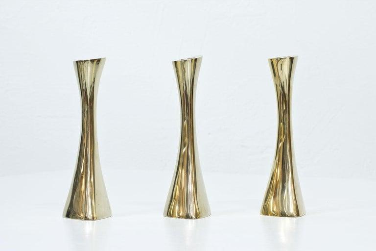 Organic shaped polished brass candlesticks designed by K.E. Ytterberg for BCA Eskilstuna in Sweden during the 1960s.