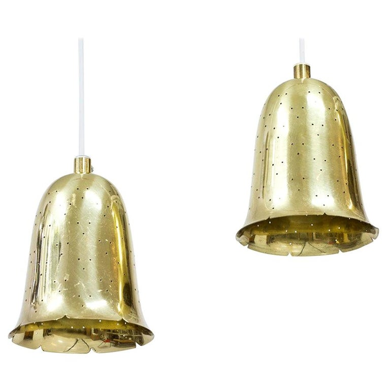 Brass bell shaped pendant lamps produced by Boréns at Borås in Sweden during the 1950s. Lamps made out of perforated polished solid brass. New electricity.