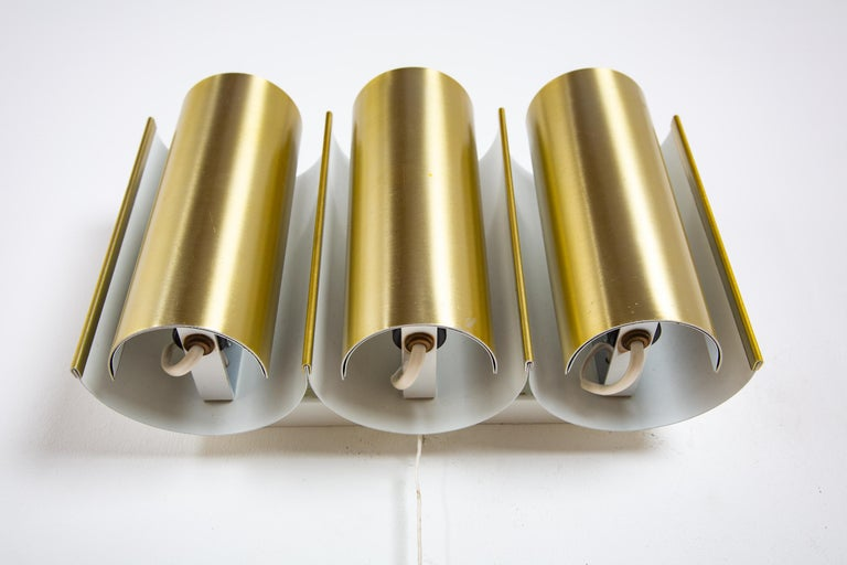 Wall lamp with three