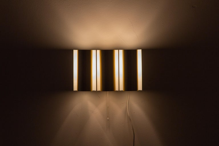 Mid-Century Modern Swedish Brass Wall Lamp in the Style of RAAK For Sale
