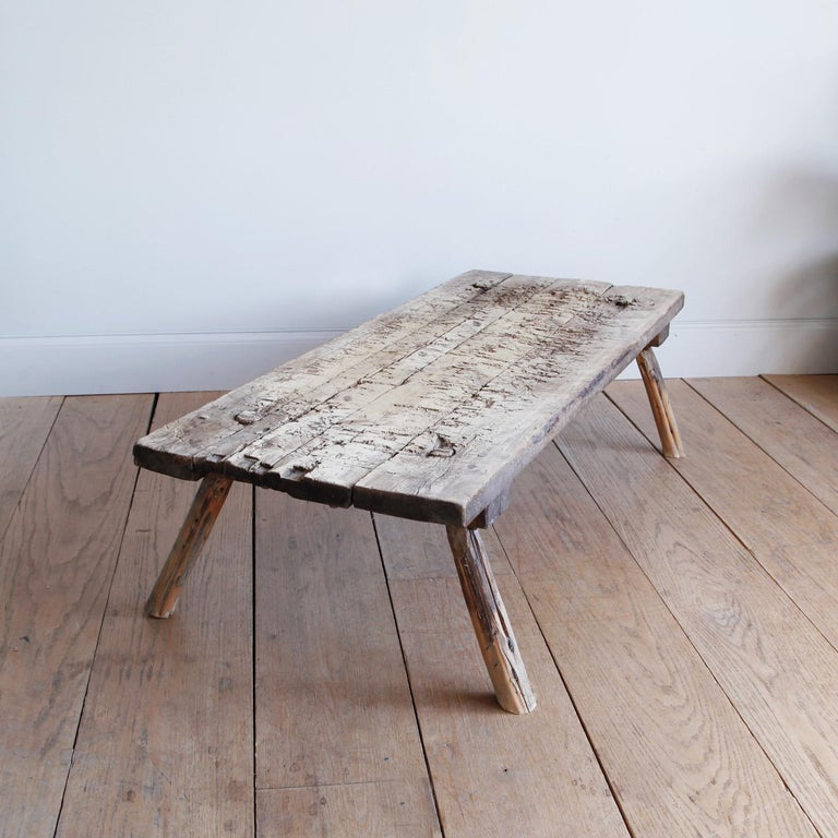 We love the rough-hewn hand-built utilitarian furniture of this period, marked with generations of use and lending a rustic, wabi sabi elegance to any interior.  This long coffee table with its splayed legs and wooden peg joinery has an almost