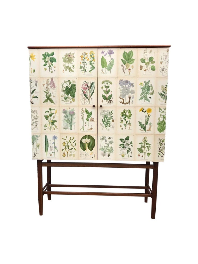 This fabulous Swedish vintage cabinet from the 1950s by famous maker FM Furniture, Linköping, 1950-1960. This piece has been restyled in our studio and covered in these amazing lithograph prints taken from C.A.M Lindman, Nordens Flora from 1926 then