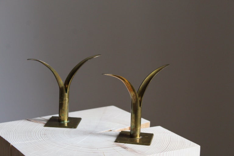 A set of candlestick / candleholders. Designed and produced in Sweden, circa 1950s. In the style of Ivar Ålenius-Björks