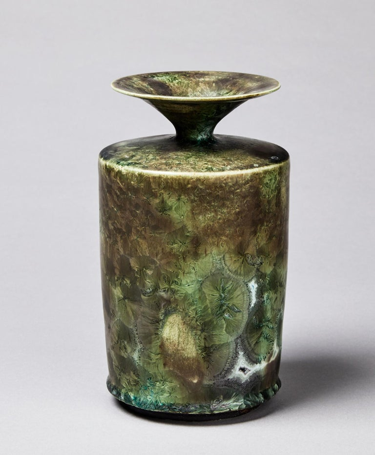 Swedish ceramic vase by Isak Isaksson, narrow necked and unique stoneware, from his own workshop. Fantastic crystal glaze in green and grey shades, signed Isak Unik. In very good condition. High-quality contemporary ceramics. Isak Isaksson are