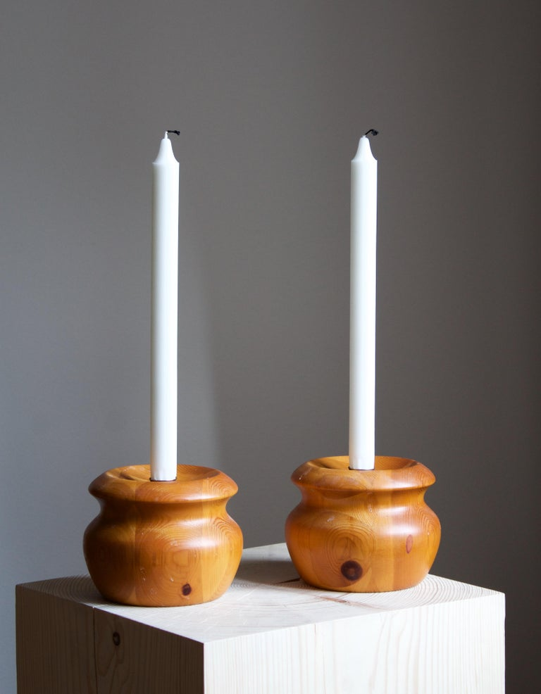 A set of Swedish candlesticks / candleholders. In turned solid pine. Brass nozzles.