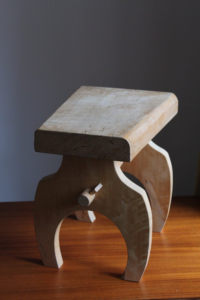 A stool or side table. Produced in Sweden by an unknown craftsman, circa 1980s  In light solid wood.   Bears original label with artists manifesto translating roughly to