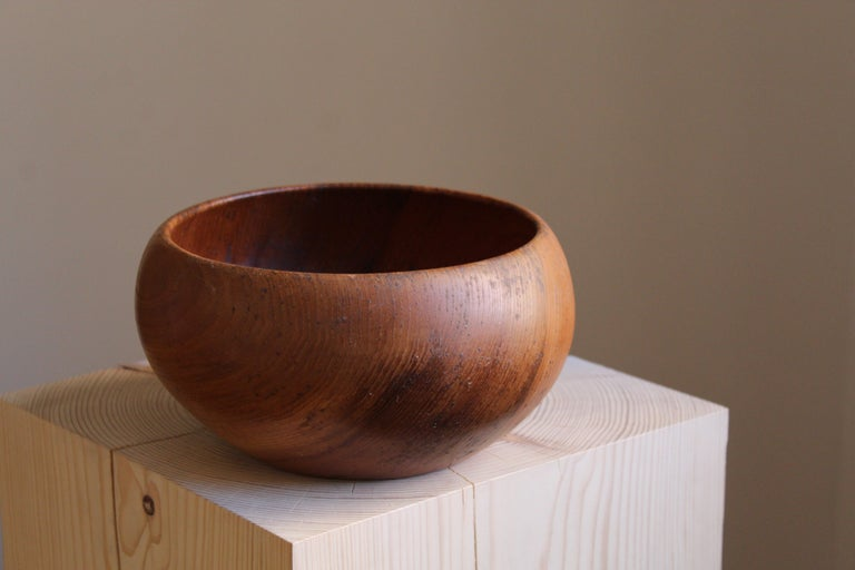 A finely sculpted solid teak bowl. Handmade Sweden, 1950s. Artists initials carved to underside.