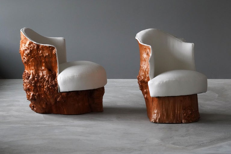 A pair of organic lounge chairs / club chairs, seats carved out of tree trunks. Features spring seats and upholstered backs. Reupholstered in brand new fabric. Produced in Sweden, circa 1960s.   Measurements of each chair:  24 W x 28 H x 30