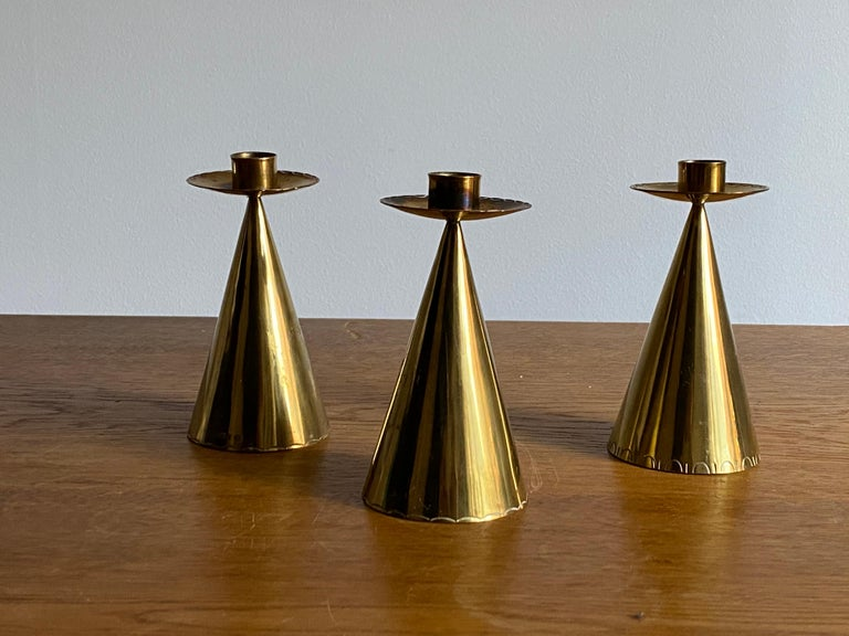A set of small brass candlesticks. Produced in Sweden, 1950s. Stamped