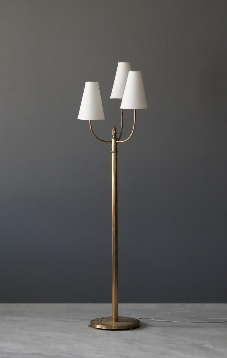 A three-armed functionalist floor lamp. With brand new high-end lampshades.  Other designers of the period include Josef Frank, Paavo Tynell, Hans Agne Jacobsen, and Alvar Aalto.