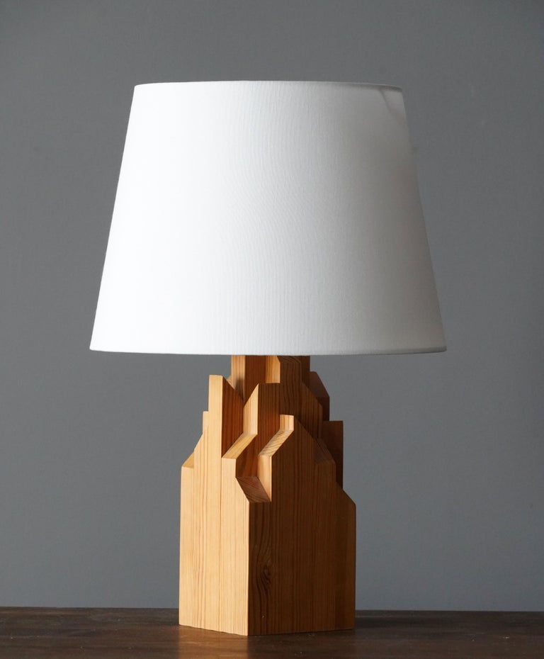 A large Mid-Century Modernist table lamp or desk light. In solid finely sculpted pine.  Lampshade is not included in the purchase.