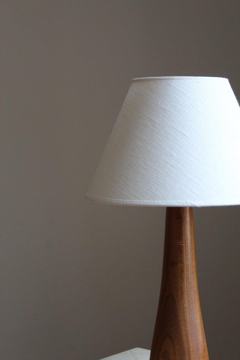 Mid-Century Modern Swedish Designer, Minimalist Table Lamp, Solid Teak, Linen, Sweden, 1960s For Sale
