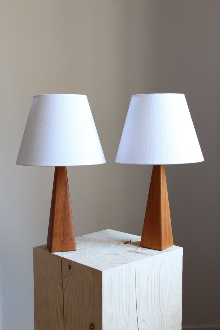 A pair of table lamps. Designed and produced in Sweden, 1960s. In solid teak.