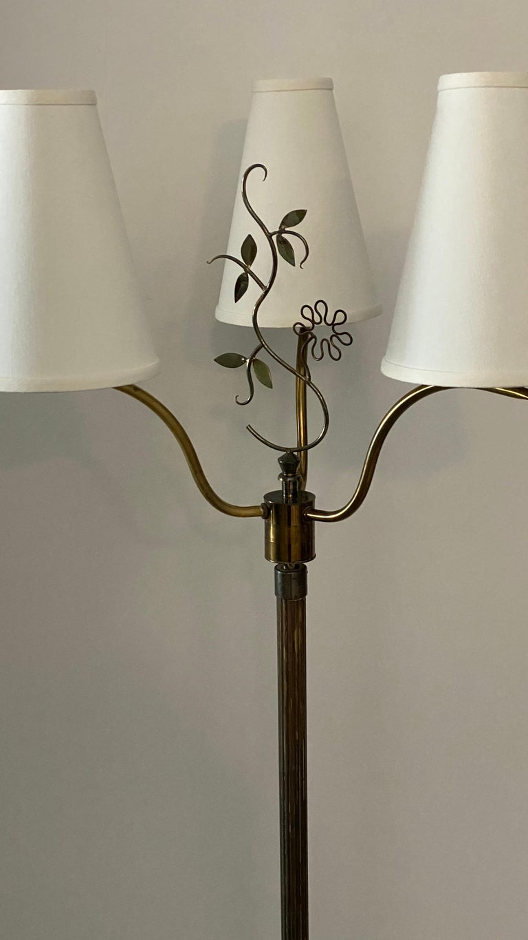 A two armed organic floor lamp. By an unknown Swedish designer and maker. In brass.   Stated dimensions are without lampshade. Lampshades are not included in purchase.  Other designers working in the organic style include Jean Royere, Alvar