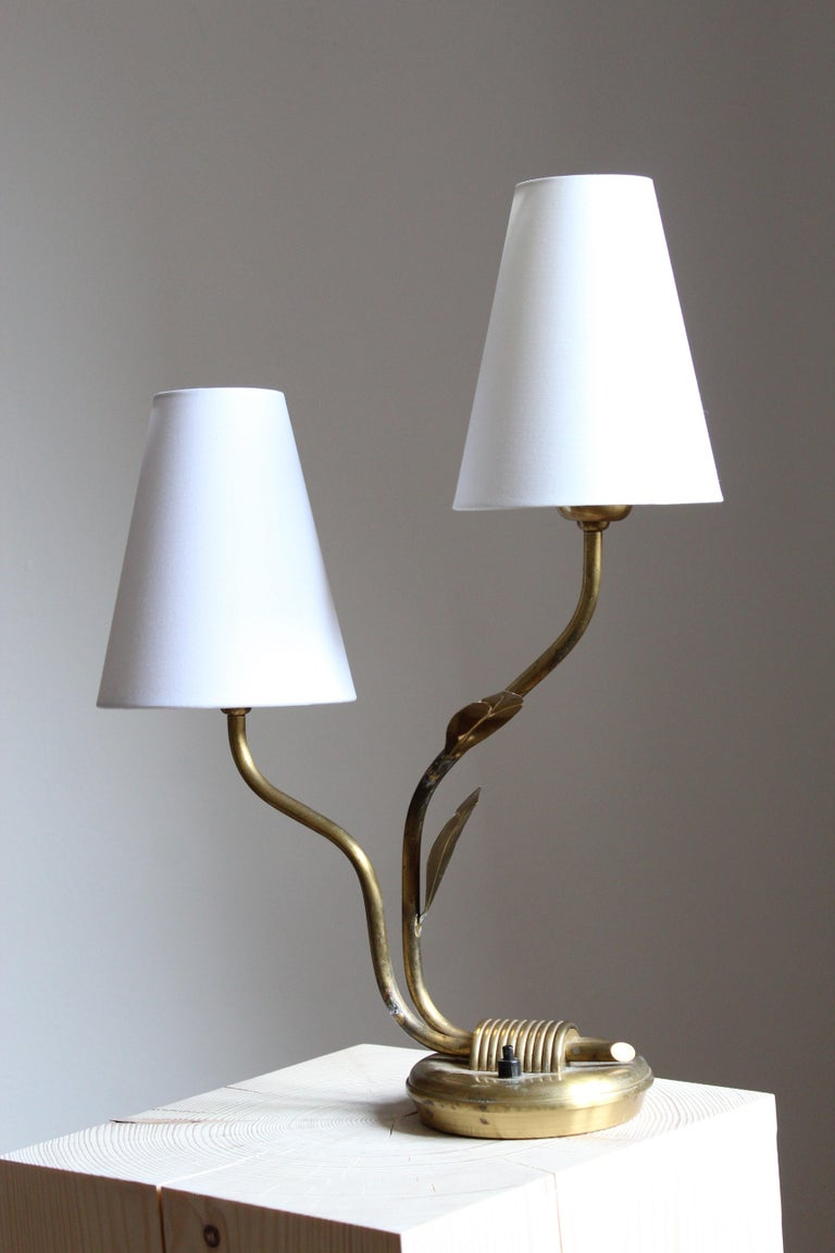 An organic table lamp. In brass. Brand new high-end fabric lampshade.  Other designers of the period include Josef Frank, Paavo Tynell, Hans Bergström, Böhlmarks, and Jean Royère.