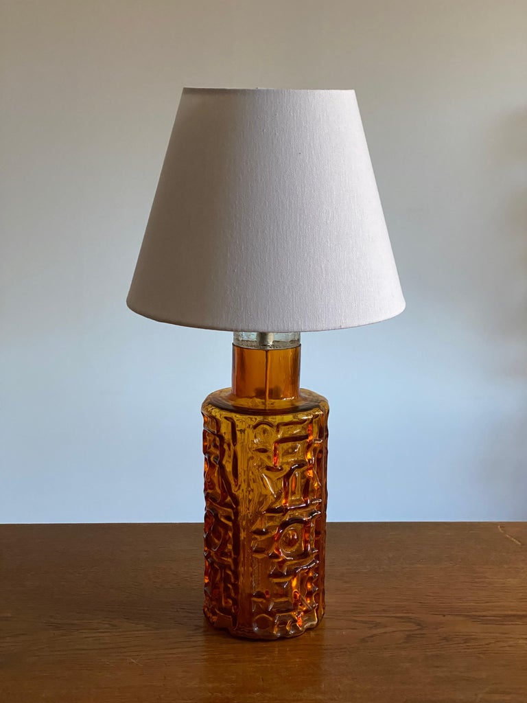 A highly modernist organic table lamp. Of Swedish production. In highly ornamented and colored glass, 1950s.   Lampshade in first image is not included in the purchase. Stated measurements are without a lampshade.  Other designers of the period