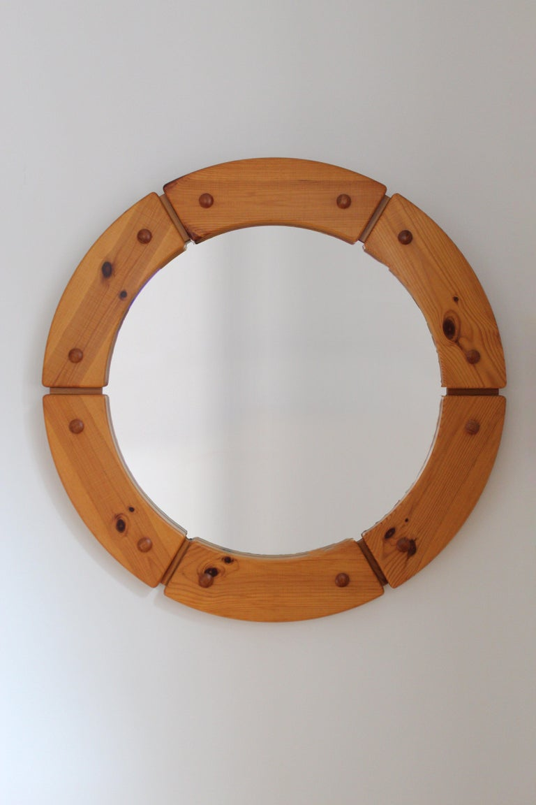 A sculptural and sizable round wall mirror, Sweden, 1960s.   Other designers of the period include Axel Einar Hjorth, Roland Wilhelmsson, Charlotte Perriand, Pierre Chapo, and Yasha Heifetz.
