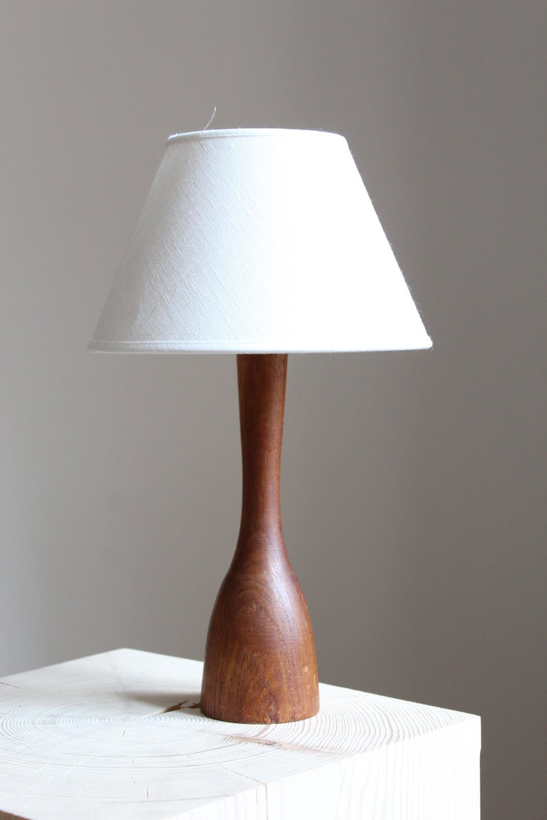 A table lamp. Designed and produced in Sweden, 1960s. In solid teak.