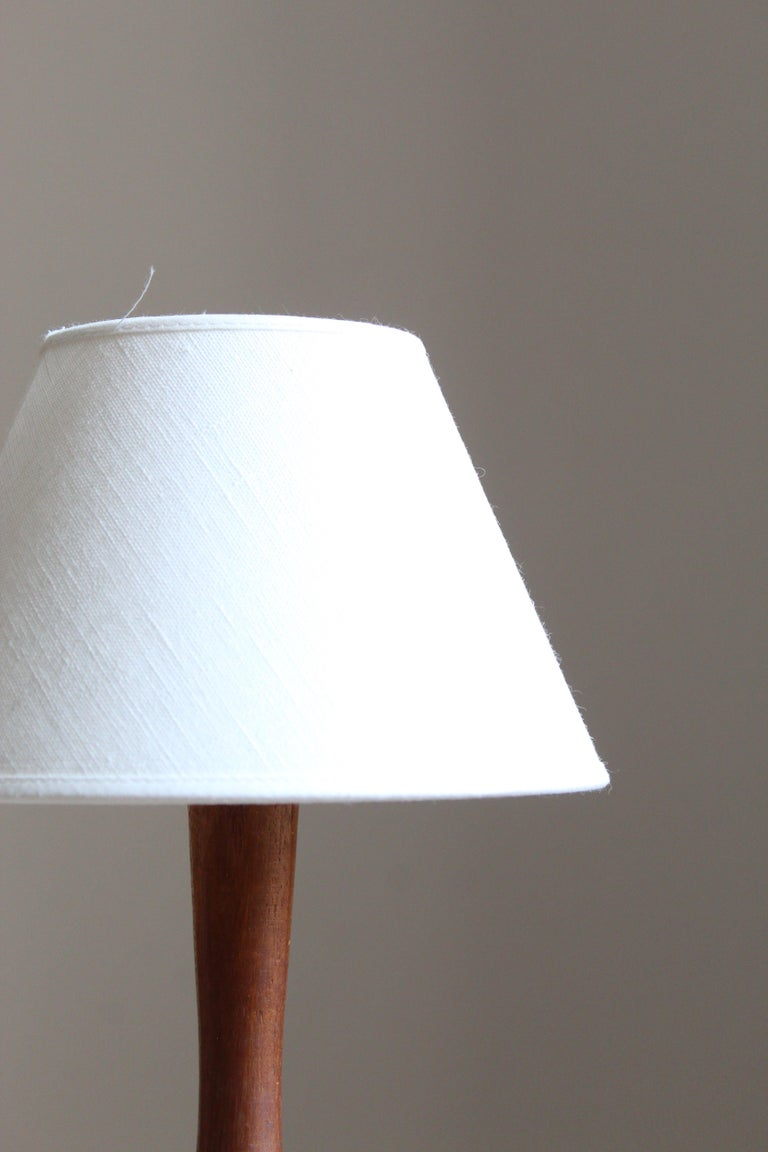 Mid-Century Modern Swedish Designer, Small Minimalist Table Lamp, Solid Teak, Fabric, Sweden, 1960s For Sale
