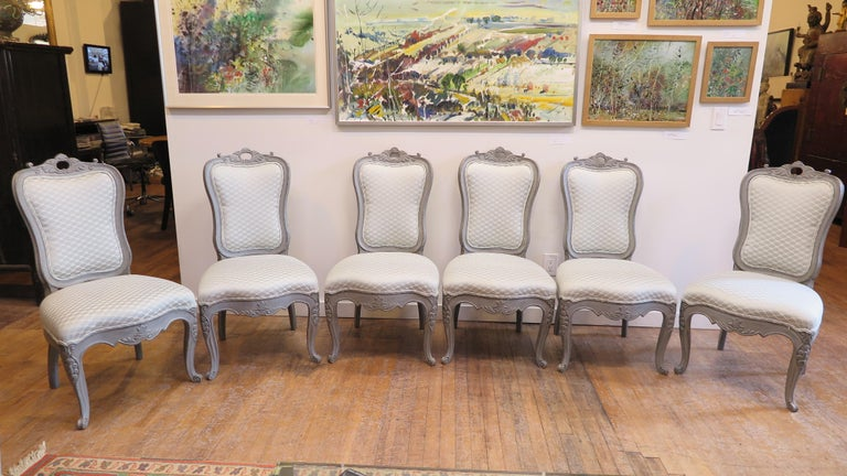 Antique Swedish Gustavian style dining chairs. Nicely carved with curved backs, very comfortable. Upholstery is good condition and can be placed as is, cushions are firm with very good support, backs and seats. Chairs are solid wood and in solid and