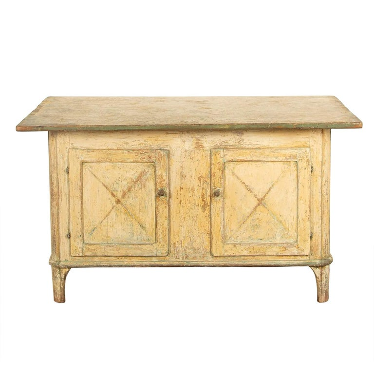 Swedish Empire workbench with fine patina. This is a useful piece of storage furniture with two cupboards to the front and two drawers to the side, the top surface sits directly in the middle of the counter so would make an excellent room divider,