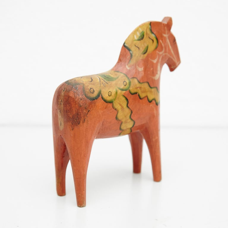Swedish wooden horse toy by unknown manufacturer, Sweden, circa 1920.  In original condition, with minor wear consistent with age and use, preserving a beautiful patina.  Materials: Wood  Dimensions: D 5 cm x W 16.5 cm x H 19 cm.