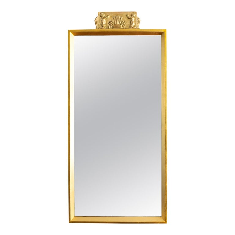 Swedish Giltwood Mirror with Decorative Carving For Sale
