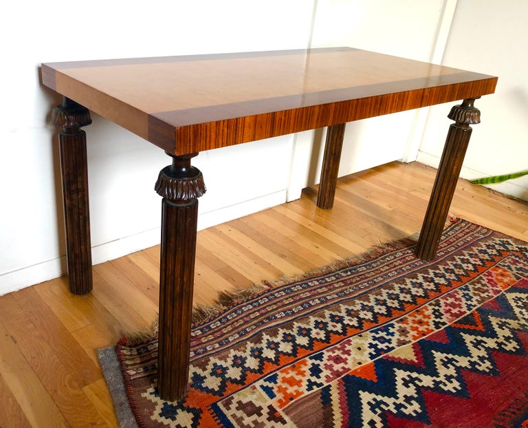 Sweden, the burl maple top with zebra wood banding, raised on dark stained birch carved column legs, circa 1920.