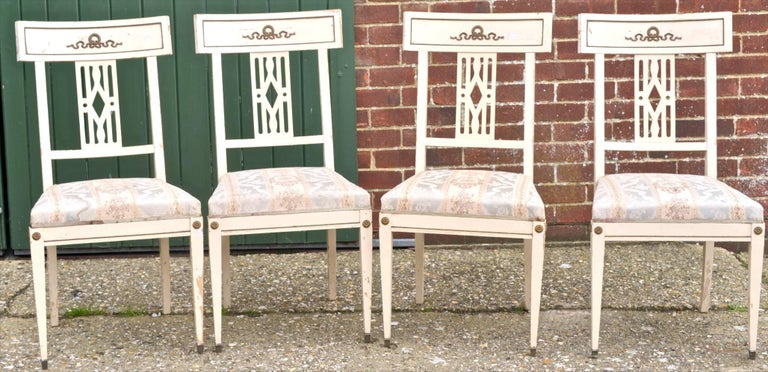 Set of six late 19th century antique Swedish Gustavian Bellman dining chairs with webbed seats and lovely brass style detailing on backrest and at the top of the pyramid legs. Very hard to find as a set of six or even four now. There is paint
