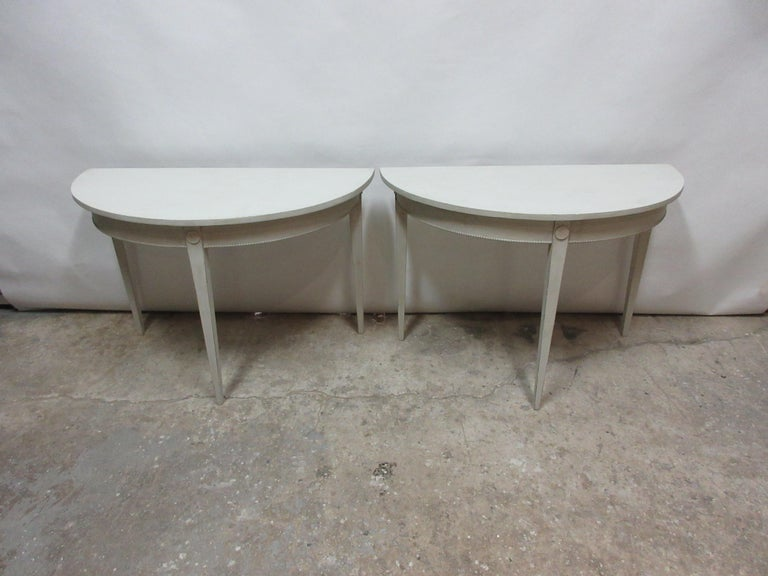 This is a set of 2 Swedish Gustavian demilune tables, they have been restored and repainted with milk paints