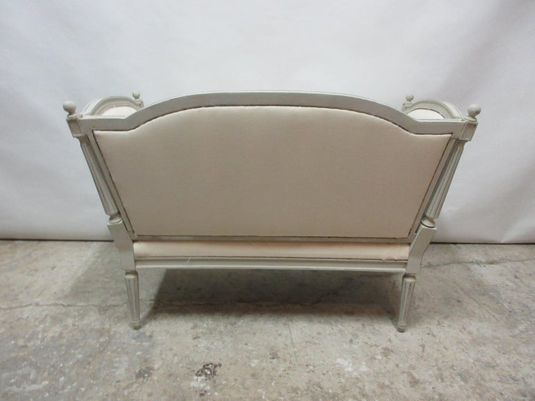 This is a Swedish Gustavian loveseat sofa. it has been restored and repainted with milk paints