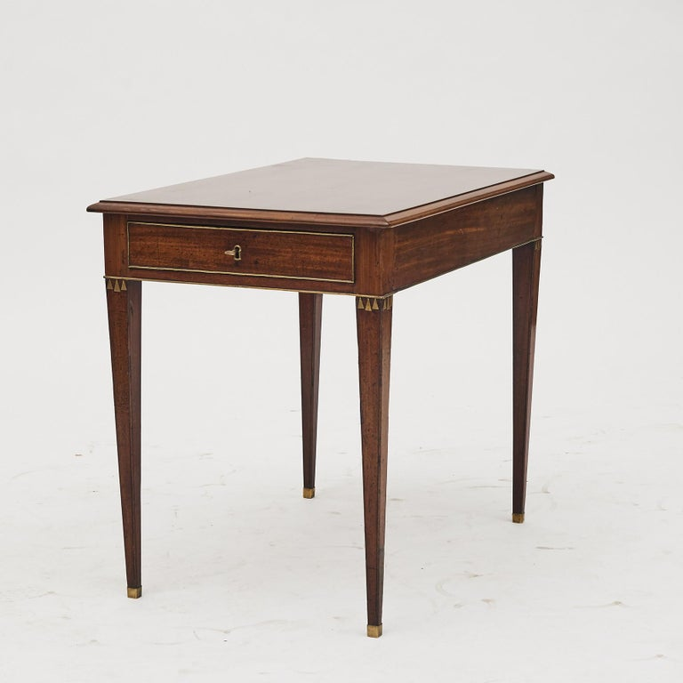 A Swedish Gustavian console table from late 18th century. Rectangular top above single drawer with brass moldings, square tapered legs with brass feet. Sweden, circa 1780-1790. Beautiful and elegant console table.