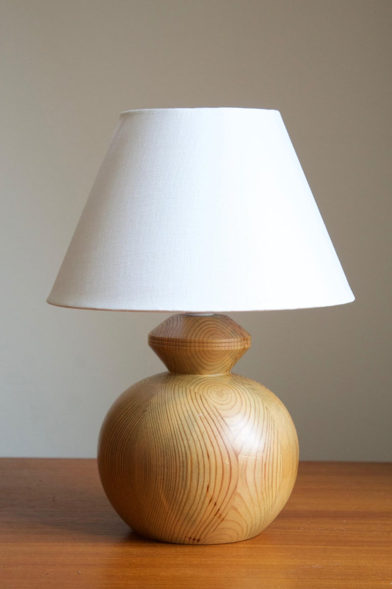 A table lamp. In solid pine. Signed NP and dated 1983.  Stated dimensions exclude lampshade, height includes socket. Upon request illustrated lampshade can be included in purchase.