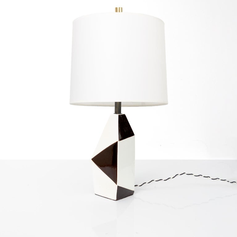 Swedish midcentury ceramic lamp by designer Carl-Harry Stalhane for Rorstrand. The lamp's body has a variety of geometric shapes alternating in white and dark brown colored glazes. Newly re-wired with custom patinated hardware including a 3-way