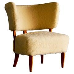 Swedish Mid Century Easy Chair in Sheepskin
