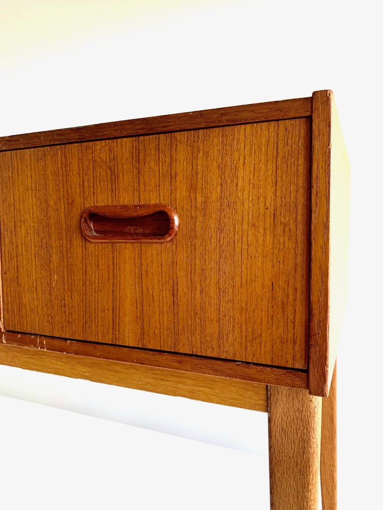 1960s Scandinavian Modern design chest featuring three drawers and tapered legs.  The vintage piece is overall in good condition.