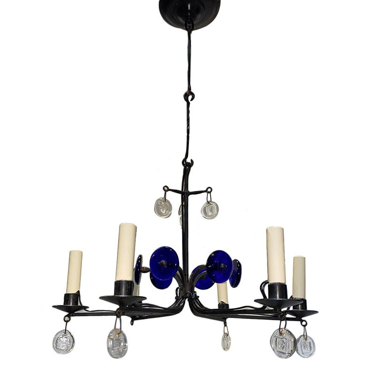 A circa 1960s Swedish wrought iron chandelier with glass pendants and blue glass elements.  Measurements: Height 13