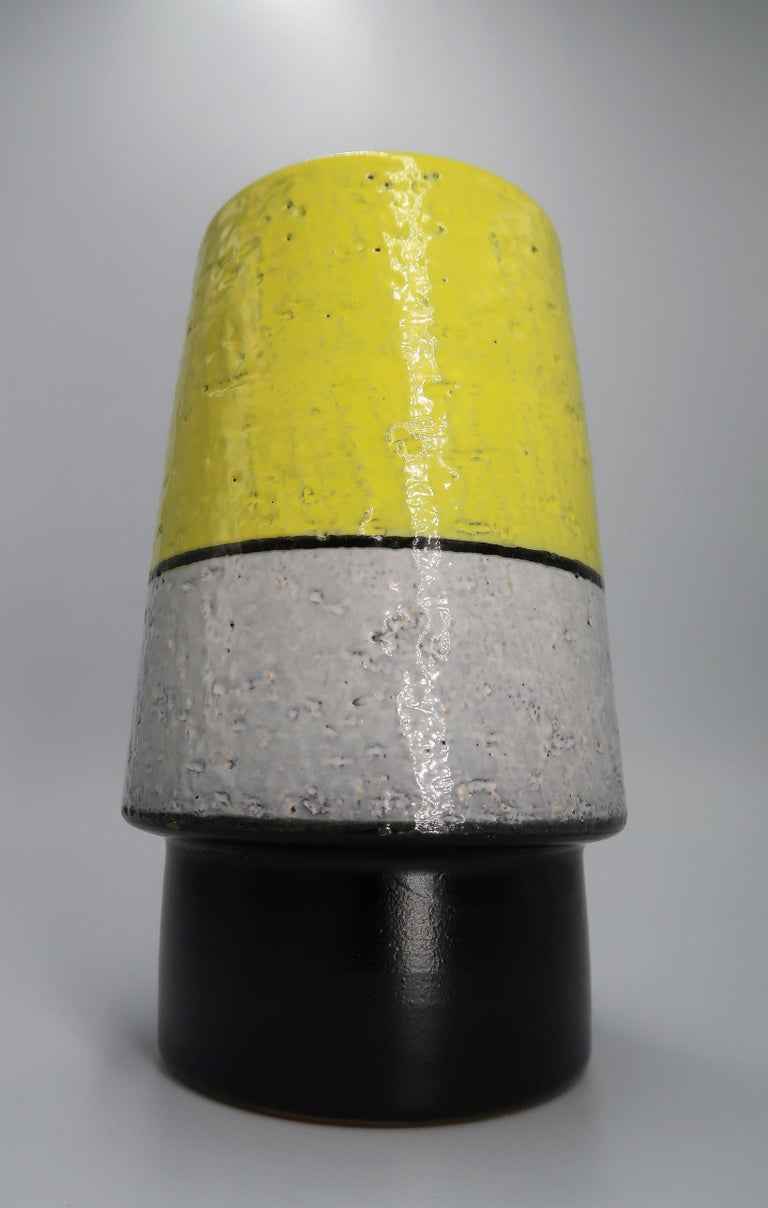 Stunning bright yellow, warm grey and smooth black Swedish Mid-Century Modern ceramic vase by designer Mari Simmulson. Manufactured by Upsala Ekeby in the 1960s. Beautiful condition. Signed and stamped under base. Model 431/441.