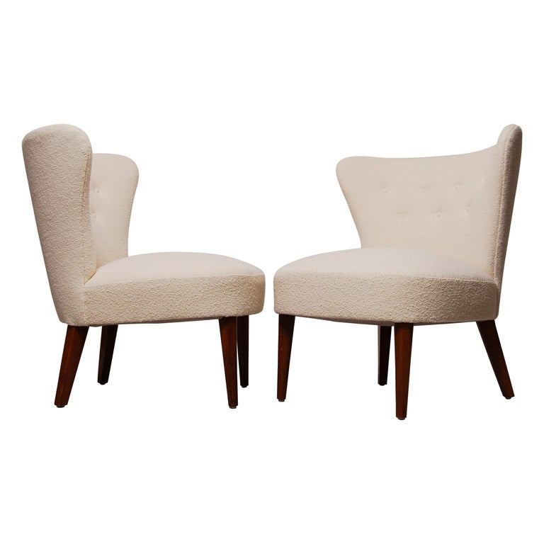 A pair of Scandinavian Modern lounge / cocktail chairs reupholstered in Knoll Classic Pearl Boucle fabric. Excellent condition.