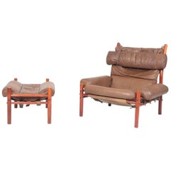Swedish Midcentury Lounge Chair and Ottoman in Patinated Leather by Arne Norell