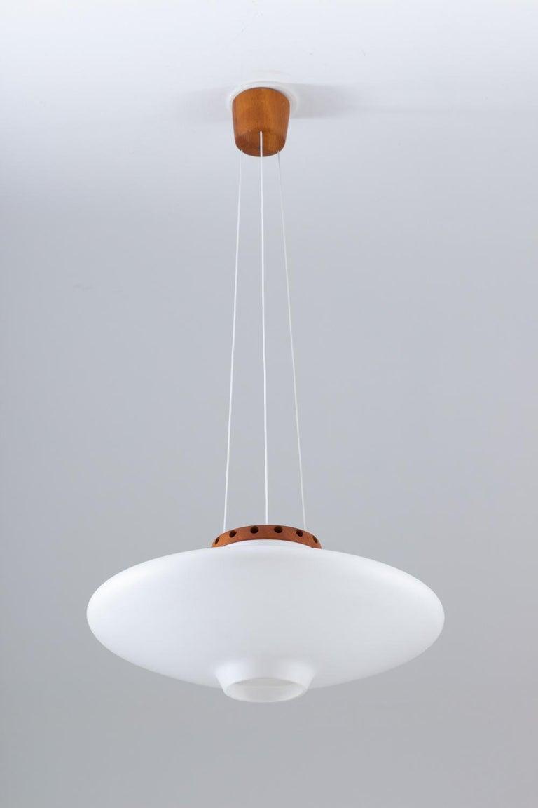 Scandinavian Modern Swedish Midcentury Pendant in Oak and Opaline Glass by Luxus For Sale