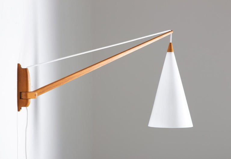 Rare midcentury Swedish swiveling wall lamp by Uno and Östen Kristiansson for Luxus, Sweden.