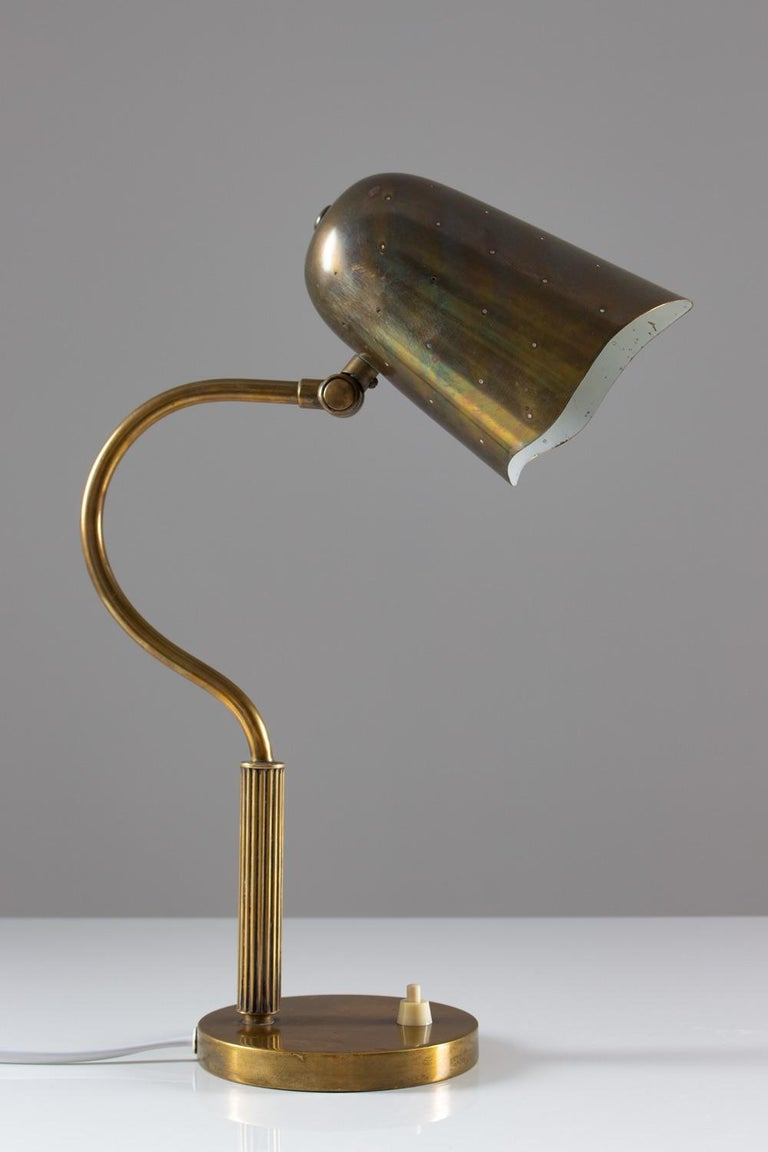 Swedish Mid-Century Modern table lamp in perforated brass attributed to Swedish manufacturer Boréns. The lamp gives a cozy, ambient light when lit. Condition: Beautiful original patina on the brass.
