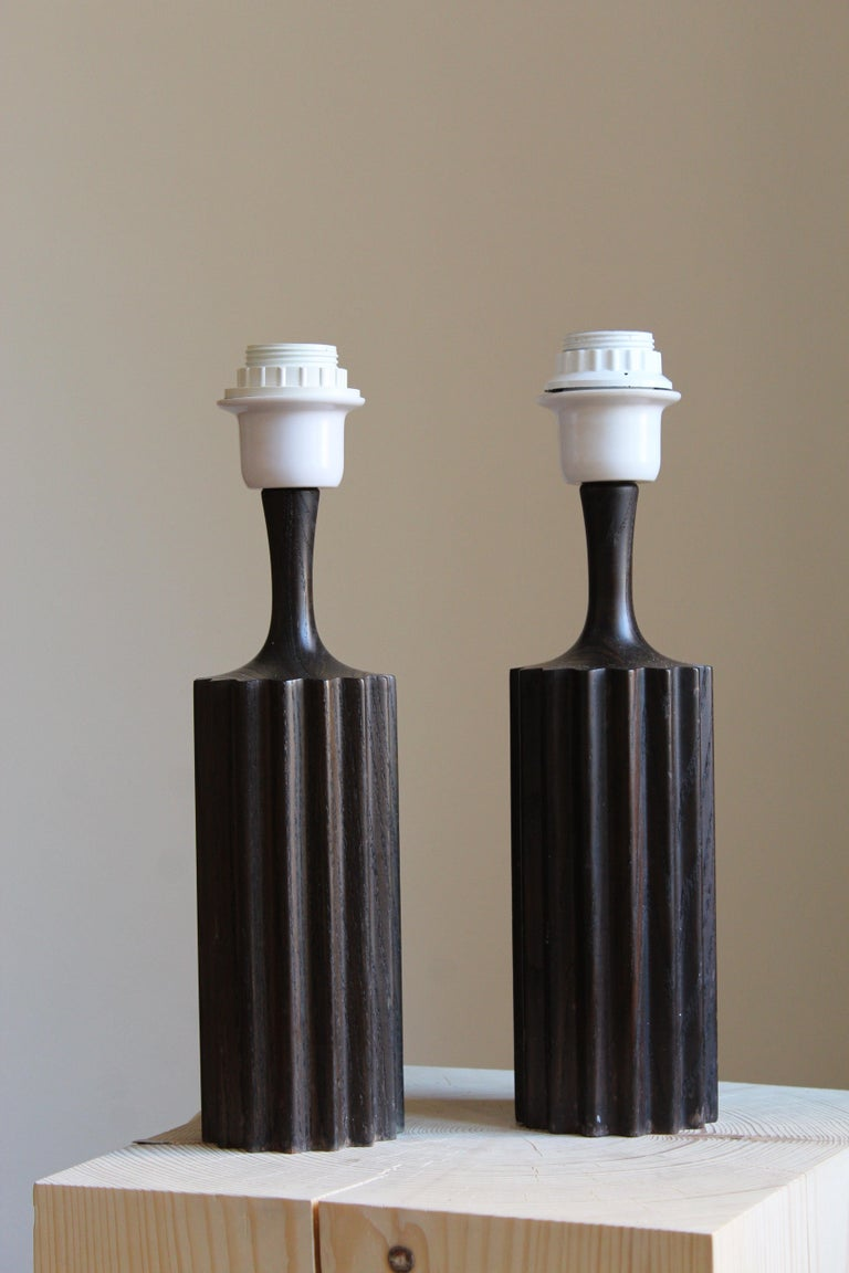 A pair of table lamps. Designed and produced in Sweden, 1960s. Features stained solid pine. Brand new lampshades.