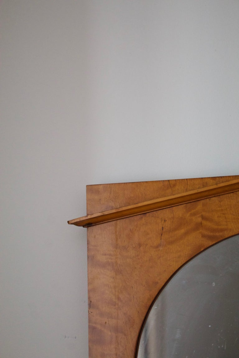 A swedish mirror, designed and produced c. 1930s. Burlwood frame and original mirror glass.