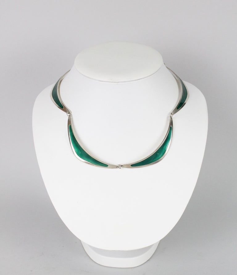 Very nice necklace in sterling silver and green enamel. Made in Stockholm, Sweden 1958 by Atelier Borgila. Very nice vintage condition. No issues!   Atelier Borgila was founded by designer Erik Fleming (1894-1954) in the early 1920s. In 1933 Borgila