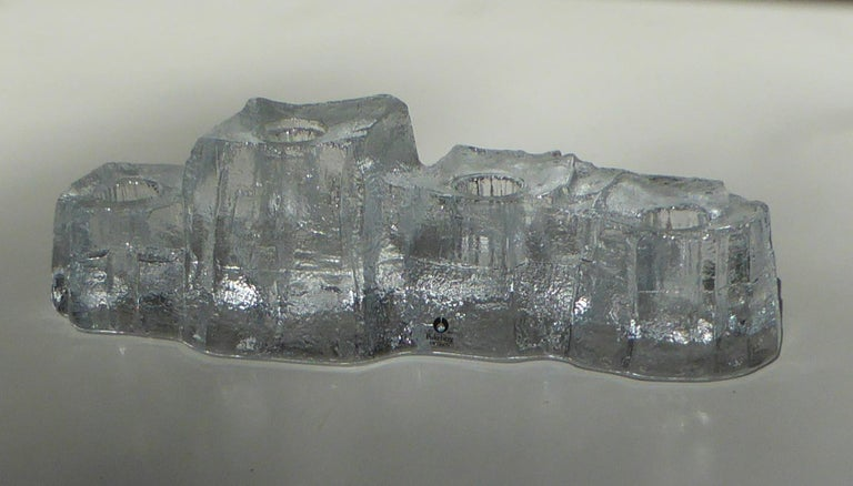 Scandinavian Modern Brutalist lead glass candleholder attributed to Uno Westerberg. Inspiration from the snow and ice covered mountains of Scandinavia, here you have a 1970s highly textured 4 candleholders by Pukeberg Glassworks of Sweden. In very