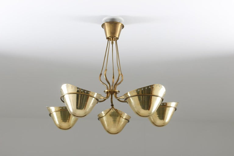 Rare pendant in brass by unknown Swedish manufacturer, 1940s. During this era, some of the most high-end lamp designs were produced in Sweden. This lamp is a great example, with its organic shapes and great quality, typical for its time. This
